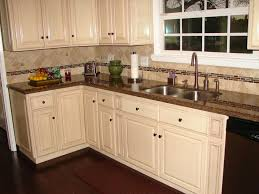2 white cabinets with baltic brown granite countertops