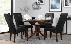 hudson round dark wood extending dining table with 4 logan brown chairs