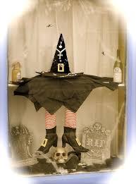 love halloween window decor: melting witch halloween window display at sherrys on main
