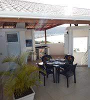 Transferências banco de imagens : Cobertura Na Area Da Churrasqueira Do Terraco Do Duplex Plus Iris Azul Foto De Residencial Jardim Dos Beija Flores Bombinhas Tripadvisor