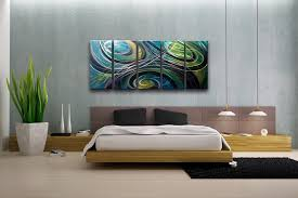 bedroom wall decor with abstract painting set on the grey wall in the bedroom completed with modern wood bed set and large potted plants in the corner
