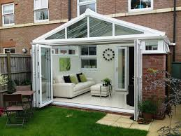 White Painted Sunroom Wall With White Polished Metal Frame Patio - Bifold exterior glass doors