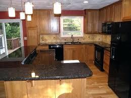 brown quartz countertops black quartz kitchen with light brown wooden cabinet black kitchen appliances small window