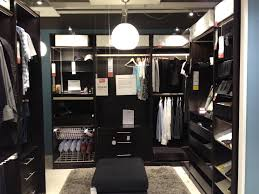 marvelous small space modern walk in closet design with pendant lights over ottoman as well as square grey rugs in modern decorating designs