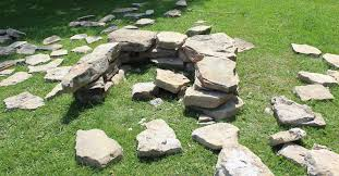 she lays out 40 old stones in her backyard now look when she starts to stack them