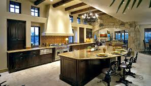 Luxury Kitchen Interior Design In Open Living Space With Elevated Ceiling.  Large Island Is Semi