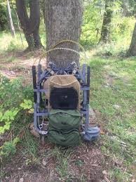 i attached an organizer and two 11 lock and load pockets i would climb with the pack on my back and the hang it in the tree with all of my gear