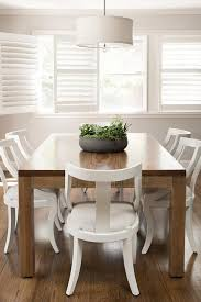 white wood dining chairs. Coffee Stained Dining Table With White Klismos Chairs Wood T
