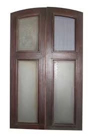 antique brownstone doors with etched glass arched tops