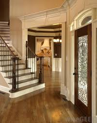 A foyer separates the front door from the main portions of the house.