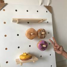 so imagine about 20 more donuts haha there are 35 peg holes in total for this board and 3 shelves of various sizes that i can use 4 originally if you