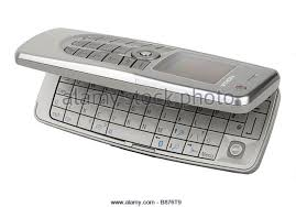 nokia with keyboard. nokia mobile telephone cellphone and keyboard - stock image with