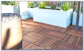 laying tile over concrete good patio tiles over concrete or deck tiles over concrete patio laying