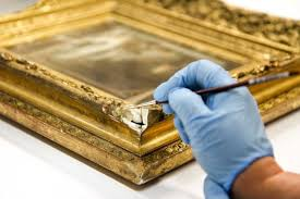 a damaged corner of a gold frame