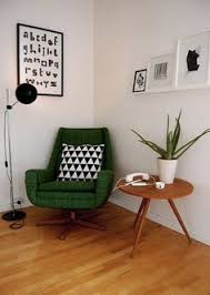 that emerald green mid century chair