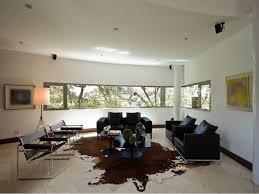 brown cowhide rug black sofa living room with cow rugs