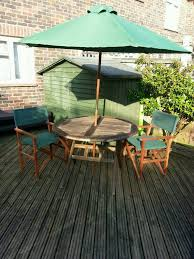 garden wooden table with two chairs and a parasol very good condition