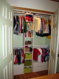 interior two white wooden doors and four hanging clothes areas also shelves also three colorful