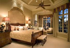 Example of a large tuscan master light wood floor and beige floor bedroom  design in Dallas