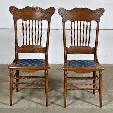 oak pressed back chairs pair