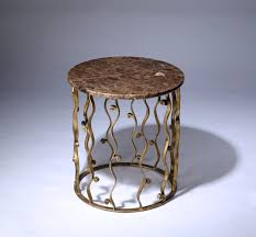 round wrought iron italian side table with marble top in distressed gold leaf finish
