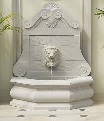 white wall hanging stone water fountain