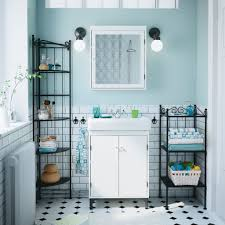 black and white bathroom furniture. a bathroom with white silvern wash cabinet and mirror black rnnskr shelves furniture