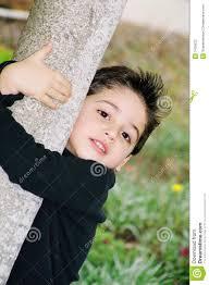 cute little boy climbing on a tree