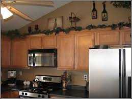 decorations on top of kitchen cabinets. Kitchen Cabinet Decoration Above Decorations Interesting 10 Ideas For Best Creative On Top Of Cabinets A