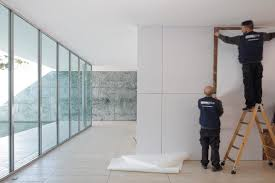 over the course of a week they are gradually hiding all the building s distinctive marble wall surfaces behind white vinyl screens