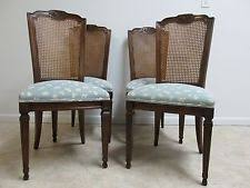 cly cane dining room chairs