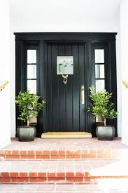 this is a door we adore there s something so stylishly simple about a clic black