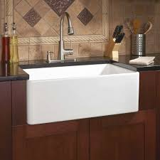 white porcelain sink. White Porcelain Sink Installed In The Kitchen With Wooden Cabinets And Black Countertops Can Easily Fit Your For