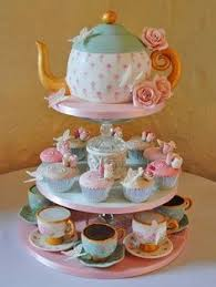 Decorating With Teacups And Saucers Add tea cups and saucers to a candlabra candle holder for 52