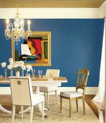 awful artwork canvas pictures hang on blue wall painted also classy brass chandelier over white rectangular dining table set as well as white flower