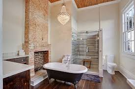 spacious transitional bathroom with cool brick feature design mlm incorporated