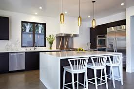 multi pendant lights over kitchen island and chair