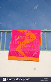 hanging beach towel. Colourful Beach Towel Hanging From Hotel Balcony