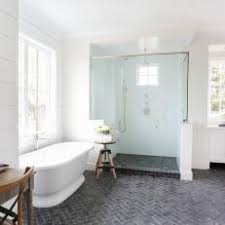 herringbone bathroom floor. spacious, bright bathroom with herringbone tile floors floor h