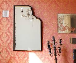the bad luck superstition of broken mirror glass dates back from the time people thought the image in the water was their actual soul