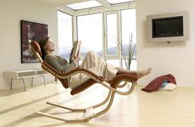Futuristic White Base Of Reading Chair With Modern Fireplace
