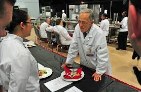 fort lee nco journal pfc nichapa srisaringkam is critiqued by american culinary federation judge gunther heiland as teammates look