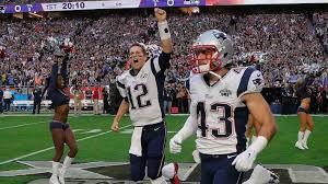 new england patriots safety nate ebner 43 runs onto the field with quarterback tom