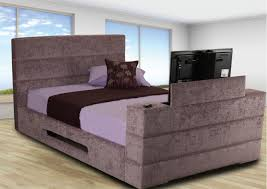 brown velvet bed with head board combined with tv place on the foot board combined with brown purple bedding set