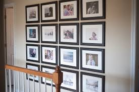 i have this quirky little hallway that i felt needed some photos i had the thermostat and light switch to contend with so i used frames of the same size