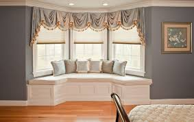 Bay Window Drapes Ideas With Banquette Seating Pillows Framed Picture Under  Recessed Lamps