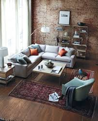 gray and orange living room. gray living room with orange pillows and