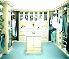 master closet islands island ideas bedroom center design cabinets and jewelry hooks mas closet island ideas jewelry arch from master
