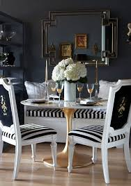 stunning dining room design with blue walls paint color horchow mosaic mirror white banquette with black white stripe cushion saarinen round marble