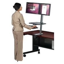 the up rite desk mounted sit stand workstation instantly transforms your existing desk into an ergonomic work space allowing you to sit or stand as you